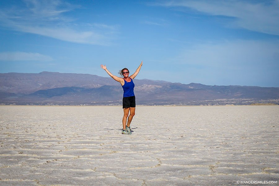 Wanders Miles, travel blogger, on the windy salt plains of Lake Assal in Djibouti, East Africa
