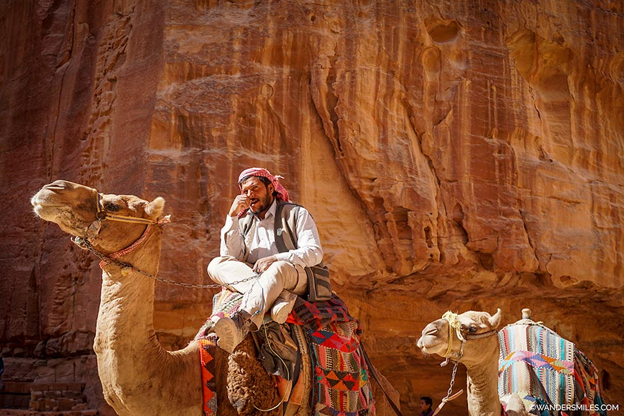Bedouin on camel at Treasury in Petra