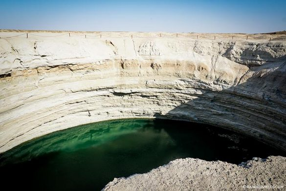 Smaller crater with volcanic water near Darvaza Gas Crater