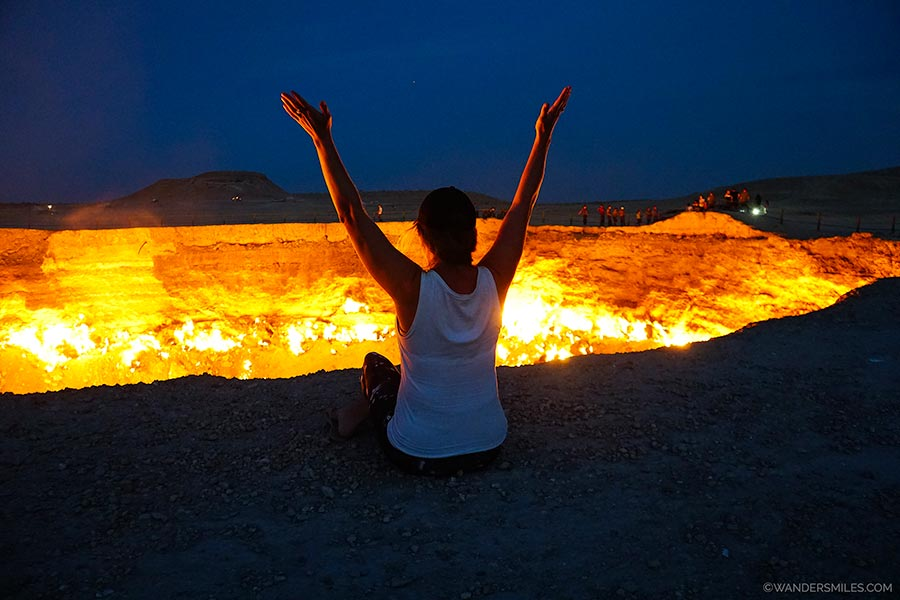 Sit by the Darvaza Gas Crater in Turkmenistan at night watching the flames