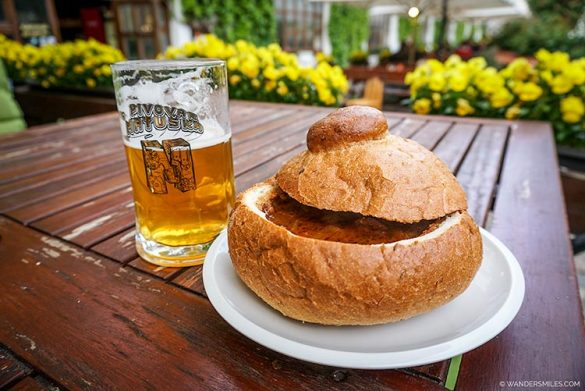 Beer and ghoulash in bread bowl at Strahov Monastery Brewery Prague