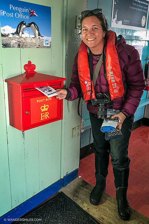 Sending a postcard from the Penguin Post Office - Port Lockroy Antarctica