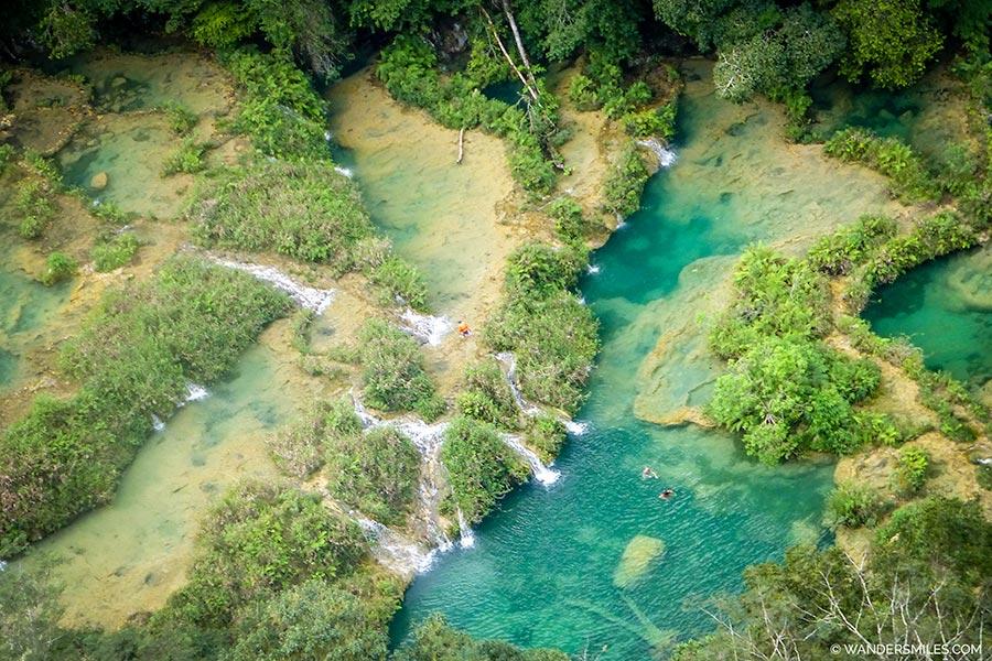 Swimming in natural water pools in Semuc Champey, Guatemala