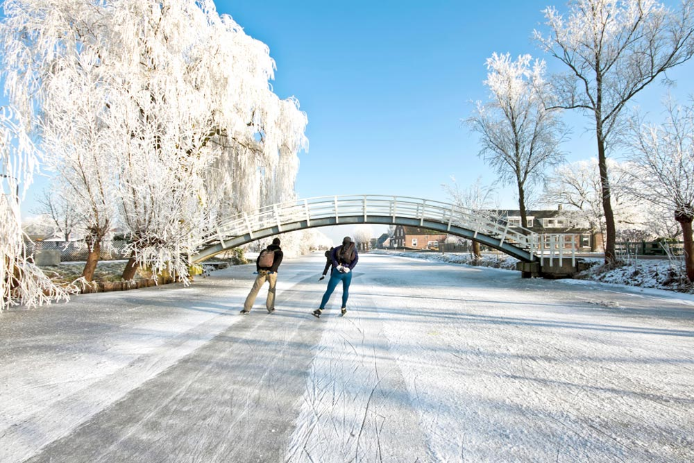Go ice skating on the canals - perfect outdoor winter activity in the Netherlands