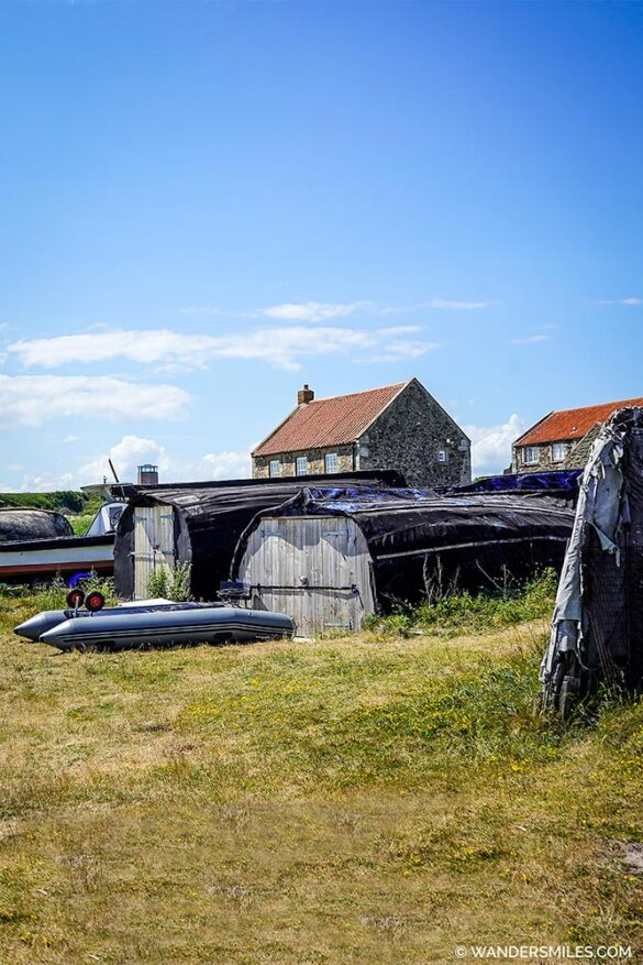 Sheds with upside down boats at Holy Island Harbour