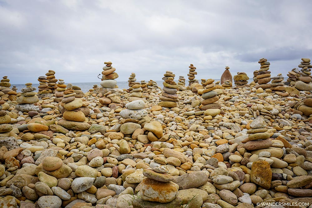 Stacked stones by Lindisfarne Castle